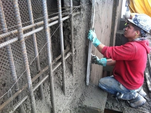 HCM Shotcrete - A six foot screed is used to cut face of wall to guide wires