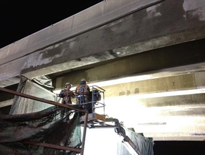 HWY 401 and HWY 62 Underpass Rehabilitation - Vertical and overhead shotcrete application at bridge girder element.